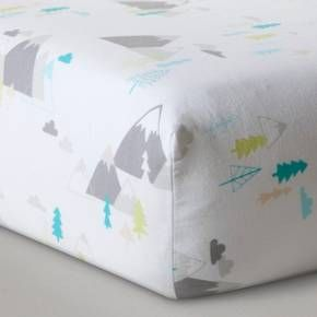 Get your little explorer ready for the great outdoors with the Blue Adventure Awaits Crib Bedding Set from Cloud Island™. Your curious little one will be romping through the forest trees and taking in the mountain views as they drift into dreamland. Blue, green and gray peaks and valleys make for a nature landscape across the adorable quilt and soft, woven sheets. The blue crib skirt with white twill trim pulls the whole look together for the ultimate adventure-themed nursery.<br&...