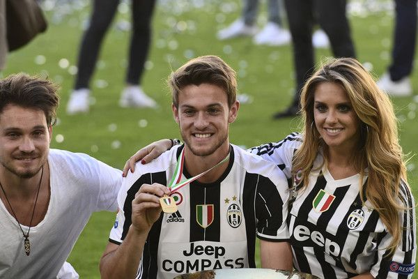 """Juventus' defender from Italy Daniele Rugani poses with the trophy after winning the Italian Serie A football match Juventus vs Crotone and the """"Scudetto"""" at the Juventus Stadium in Turin on May 21, 2017. First-half goals from Mario Mandzukic and Paulo Dybala, and a late header from Alex Sandro sealed a 3-0 win over Crotone to hand Juventus a record sixth consecutive Serie A title today. / AFP PHOTO / MIGUEL MEDINA"""