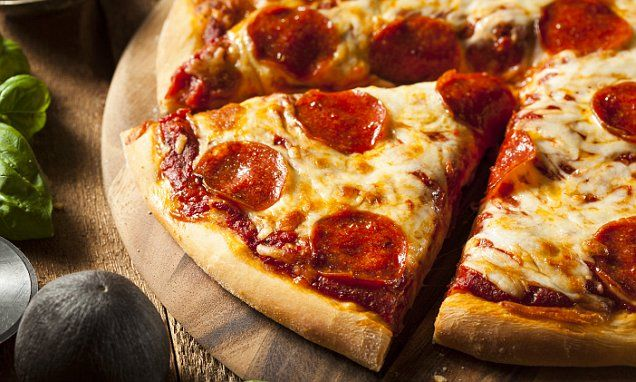 How to perfectly reheat a slice of pizza 1. Put a slice of cold pizza in a skillet on a medium to low heat.