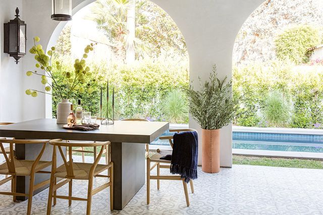"Despite all the beautiful rooms in this Spanish Revival home, the designers' favorite thing about the space is the bifold doors that open to the charming backyard and pool. ""It's really a quaint..."