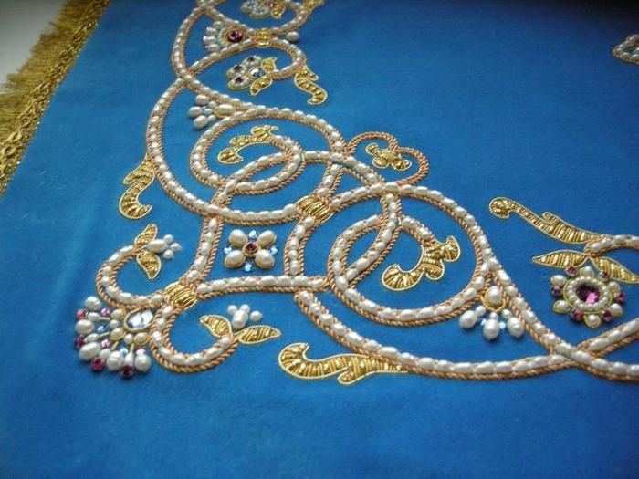 Russian embroidery- Beautiful curves and use of gold thread and pearls.
