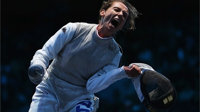 Valentina Vezzali of Italy celebrates beating Astrid Guyart of France in the women's Foil Team Fencing semi-final on Day 6 of the London 2012 Olympic Games.