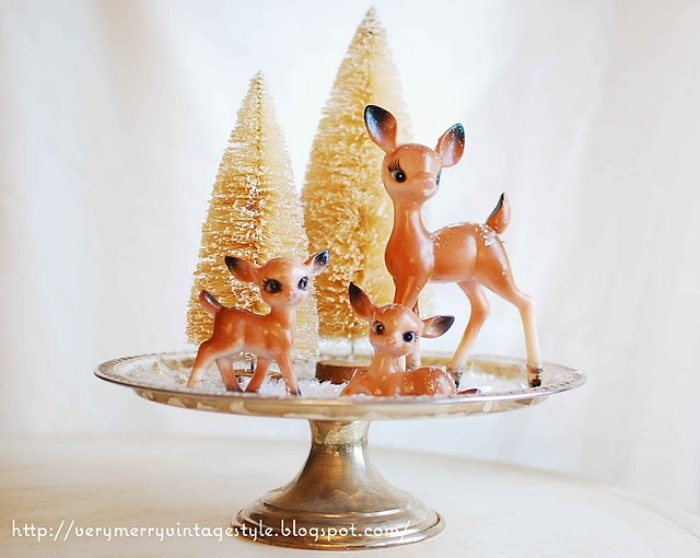 "Vintage Christmas deer decor.  My Aunt had these deer when I was a child.  They sat on the antique buffet in the dining room surrounded by ""snow"".  I adored them."