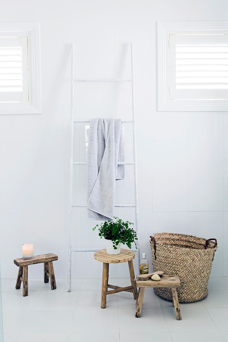 "Natural materials such as timber and wicker look right at home in this white ensuite. See more of [Bernadette's breezy beach house](http://www.homestolove.com.au/gallery-bernadettes-breezy-beach-house-1980|target=""_blank""). Photo: Maree Homer / *homes+*: [object Object]"