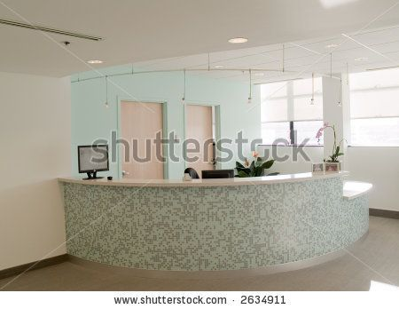 Love the colors.  The mosaic tile on the curved reception desk with the square edge white top.  Great clean track lighting and pretty accent wall color.       stock photo : Reception desk in a medical office