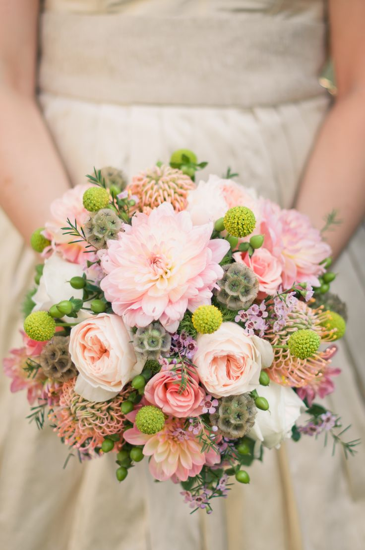 Soft pinks and greens are the colors for this bouquet. Soft pink roses,  dahlias