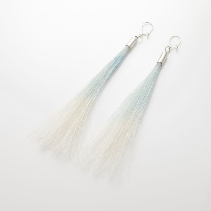 A series of jewellery designed and made by Annea Lounatvuori. Coloured horsetail and silver. All unique and different.