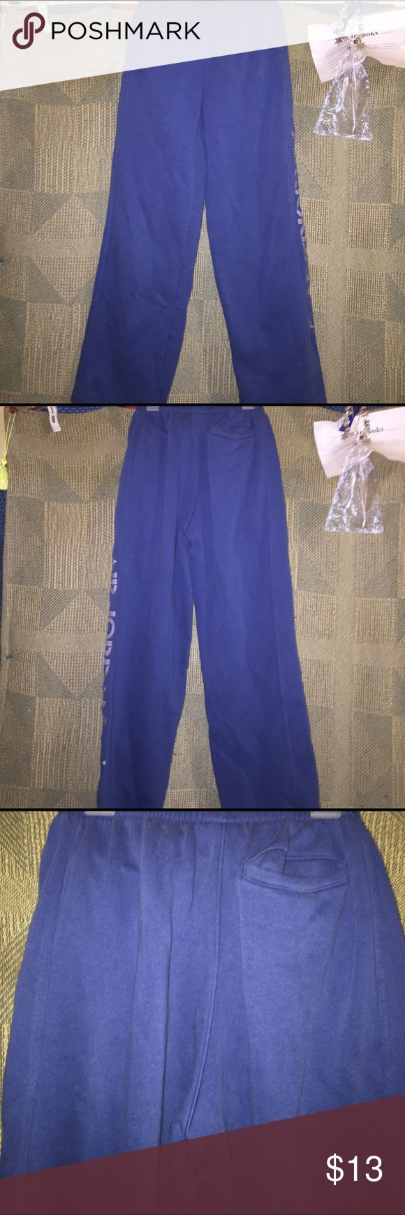 Air Jordan sweats boys size large blue with grey Boys size large air Jordan sweat pants blue with grey writing down the side of leg, great condition two pockets in front and one back pocket, clean but may want to wash before wear🚬🐱🏡 Air Jordan Bottoms Sweatpants & Joggers
