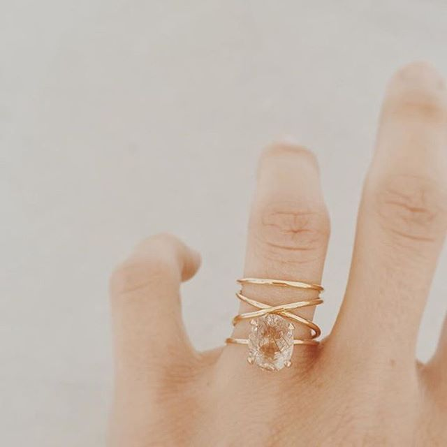 """Loving this custom wedding set by @nataliemariejewellery Oval cut Rutilated Quartz with stacked crossover #wedding set. Handmade in 18K gold ✨ #jewelry…"""