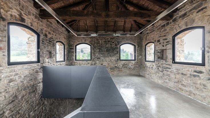 A medieval tower in the centre of Villa d'Adda, Italy has been ingeniously renovated by architect Gianluca Gelmini to incorporate stark, angular staircases and a copper-clad extension.