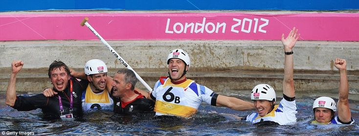 Gold medallists Etienne Stott (second left) and Tim Baillie (right) celebrate with silver medallists David Florence (second right) and Richard Hounslow (third right) of Great Britain after the men's canoe double (C2) slalom final