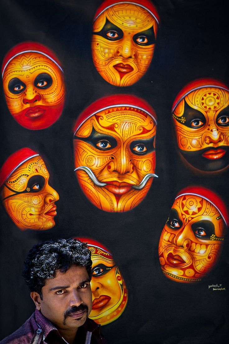Artist selling Theyyam dancers painting, Bangalore, India