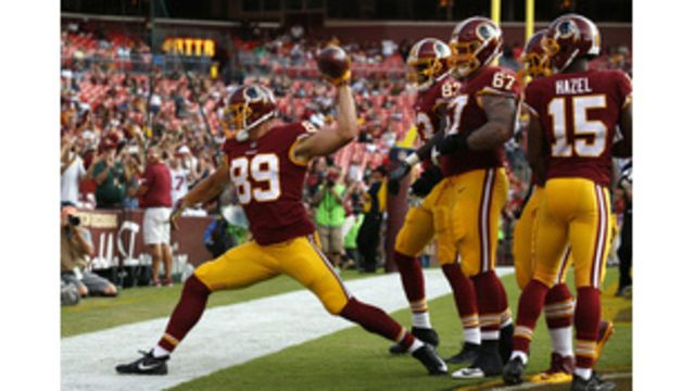 Washington Redskins tight end Derek Carrier (89) spikes the ball in front of teammates after scoring a touchdown in the second half of a preseason NFL football game against the Cincinnati Bengals, Sunday, Aug. 27, 2017, in Landover, Md. (AP                             Copyright 2017 The... - #Dalton, #Debuts, #News, #Redskins, #Reed, #Sharp, #Story, #Te