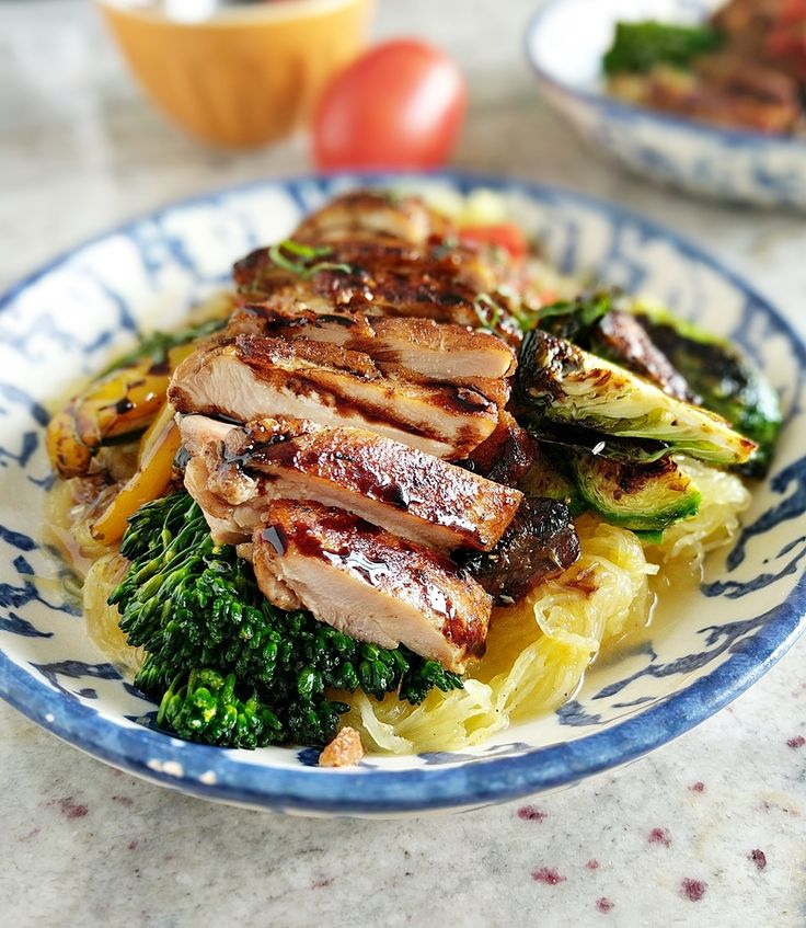 This post has 15 healthy protein bowl recipes that are easy to make, and super nutritious! My version is a balsamic chicken with glazed vegetables served over spaghetti squash. It's low carb, gluten free and a tasty Italian treat!