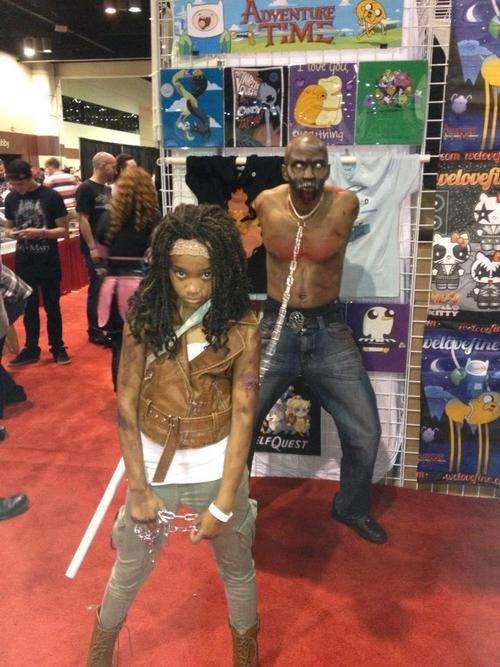 A girl and her dad: best. Cosplay. Ever.  Michonne rocks... Parenting done well!