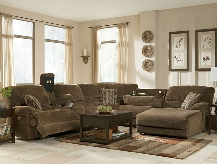Comfortable Big Sectional Sofas : Rustic Brown Sectional With Chaise And And Table On The Brown Rug And White Floor Paired With Art Decorati...