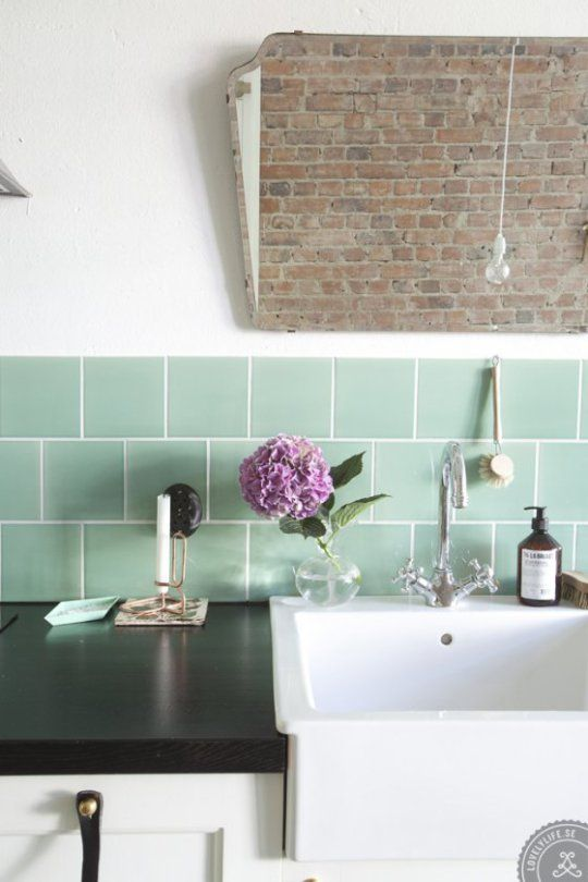 black and mint w/a splash of purple...cool brick feature...love the simplicity of the light...not to mention that sink :) ...