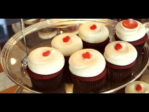 Red Velvet Cupcakes Recipe | Georgetown Cupcake | Get The Dish fluffy cream cheese frosting on top
