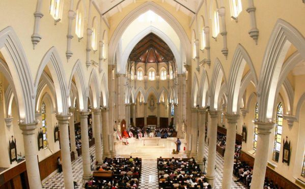 CATHOLICS IN HONG KONG ARE ATTENDING A MASS.