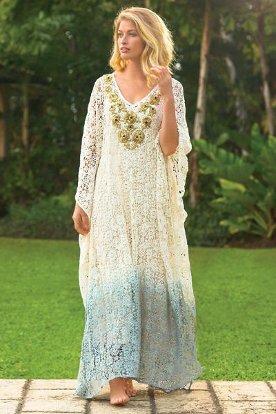 "Gleaming golden rosettes of hand-sewn metallic zardozi embroidery and beading bring radiant embellishment to our glamorous crocheted lace caftan, dip-dyed in a chic tint and detailed with 3/4 dolman sleeves and side slits. Cotton. Misses 51"" long. Jarana Caftan #29034"