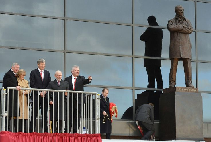 November 23 2012: Ferguson (L) attends the unveiling of a statue commemorating his career at the club with his wife Catherine (2nd L), club chief executive David Gill (3rd L), sculptor Philip Jackson (4th L) and television presenter Eamonn Holmes (R), at Old Trafford