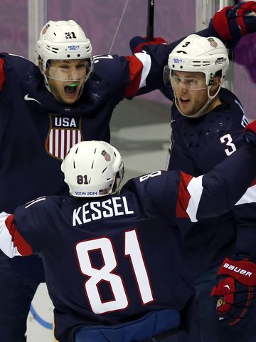USA defenseman Cam Fowler (3) celebrates with teammates Phil Kessel (81) and James van Riemsdyk (21) after scoring a goal against Russia.
