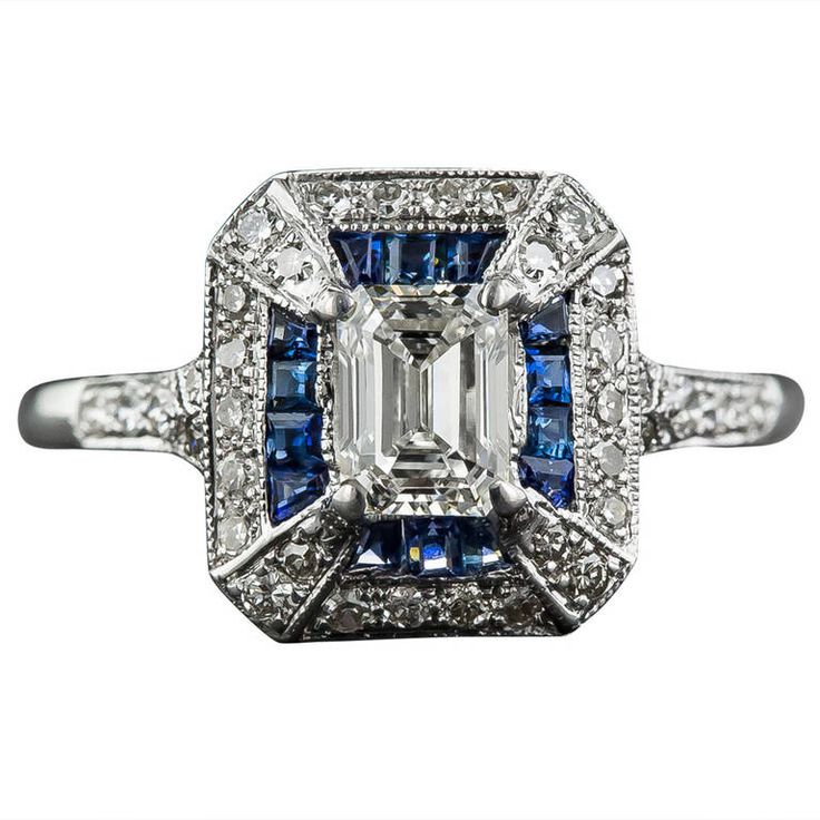 .69 Carat Emerald-Cut Art Deco Style Diamond and Calibre Sapphire Ring | From a unique collection of vintage engagement rings at https://www.1stdibs.com/jewelry/rings/engagement-rings/