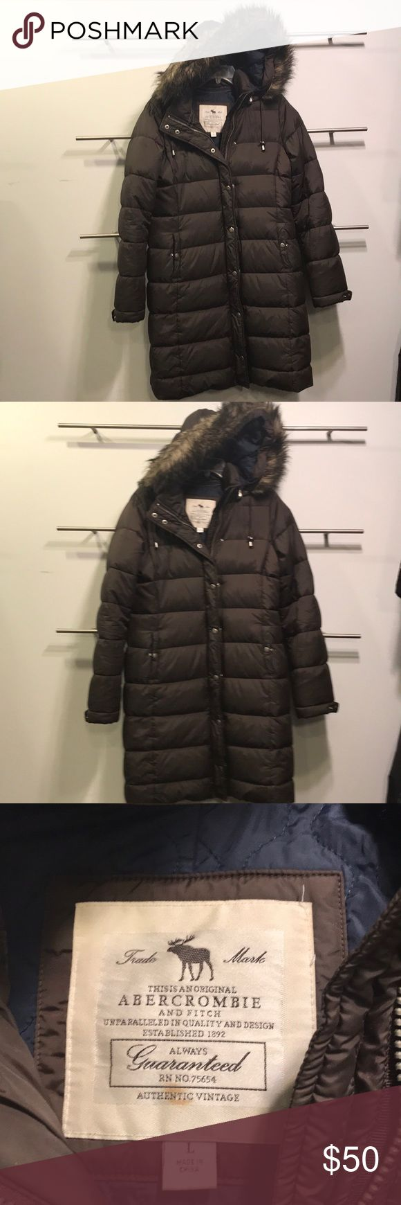 ABERCROMBIE AND FITCH JACKET LONG AND HEAVY LARGE This is a Abercrombie and Fitch jacket. It is brown in color. It is long and heavy. Great for winter and in great condition. It is a size large. Abercrombie & Fitch Jackets & Coats Puffers