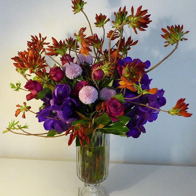 Stunning wild vase of Azalea, Roses, Vanda Orchids and Pom Poms.