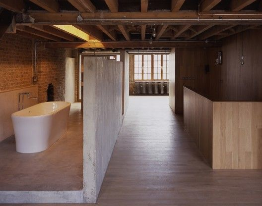 A great factory reconversion by British practice Dow Jones Architects with a great mixture of brick, wood and concrete.