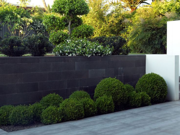 Traditional: Honed bluestone traditional format walling garden wall
