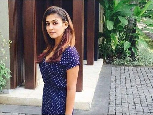 side parted and combed long hair from nayanthara