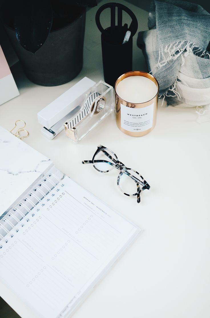 black framed eyeglasses beside spiral notebook Work from