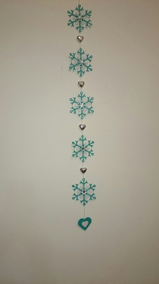 Wall decoration made using Stampin Up snow flurry bigz die