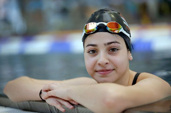 The Inspiring Yusra Mardini: the 18-year- old Olympic refugee swimmer who saved 20 lives from a sinking boat wins her heat of the 100m butterfly.  Team Refugee Athletes. Mardini fled Syria with her sister; part of their journey included pushing their flooding, overcrowded dinghy through the Mediterranean Sea as the strongest swimmers on board.