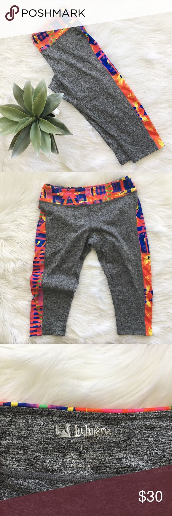 """Lularoe Jade Athletic Cropped Workout Legging Lularoe """"jade"""" cropped athletic legging size large. Colorful abstract print on the sides. Inseam 19 inches. No stains or holes, smoke and pet free home! Offers welcomed! LuLaRoe Pants Leggings"""