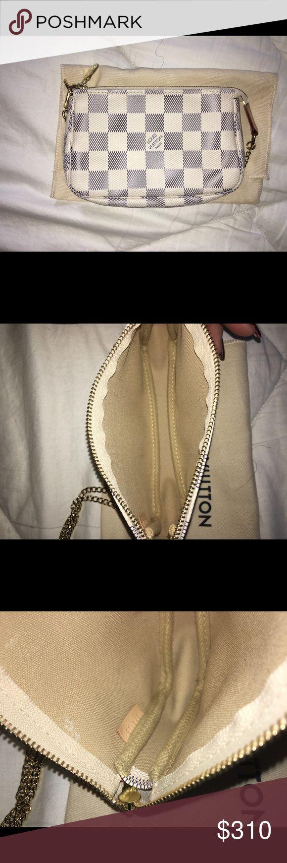 Louis Vuitton Mini Pochette Damier Azur 👜Mini Pochette Accessoires Damier Azur  Retails for $310  5.5x 3.5x 0.8 inches  (Lengthx Heightx Width)  Zipper closure Textile lining Golden metallic brass pieces including the chain Can be carried on the wrist Louis Vuitton Bags Clutches & Wristlets