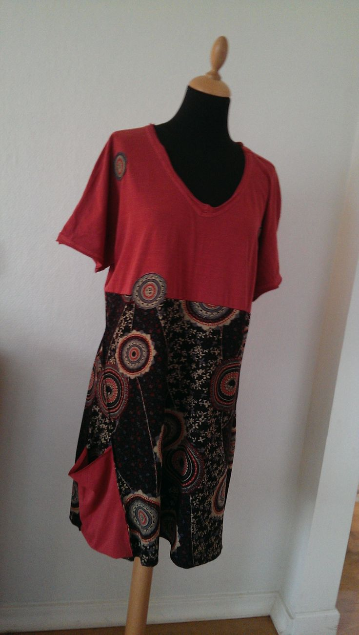 A new dress re-designed using  an old T-shirt and some new fabric.