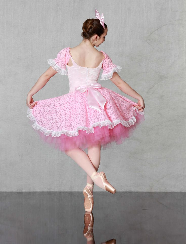 "KISSY DOLL - Dainty delight! Our ""Flexi Fit"" classical ballet bodice leotard and basque of sugary pink stretch velvet and lots of lace. 6 layer romantic tutu with generous layers of tulle and lace top skirt. Bows included, made just for you n all child and adult sizes....ADORABLE!"