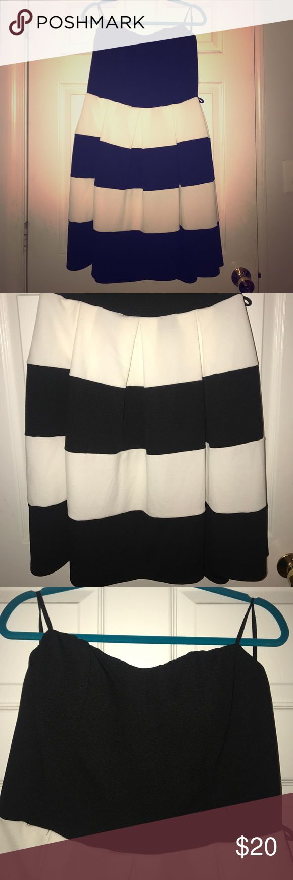 Strapless Flattering night out dress 👗 This dress is form fitting and flowy 😍 black and white.   Please note it came with a missing belt and it has never been worn (as shown in pictures) Fashion to Figure Dresses