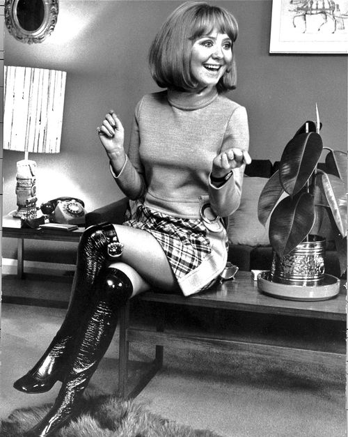 "Lulu - A Scottish singer and actress most famous for ""To Sir With Love"" (the song and the film) and being a tiny adorable little firecracker -- Women in the 60s - Lulu is  65 yrs young these days and still cute as a button!"