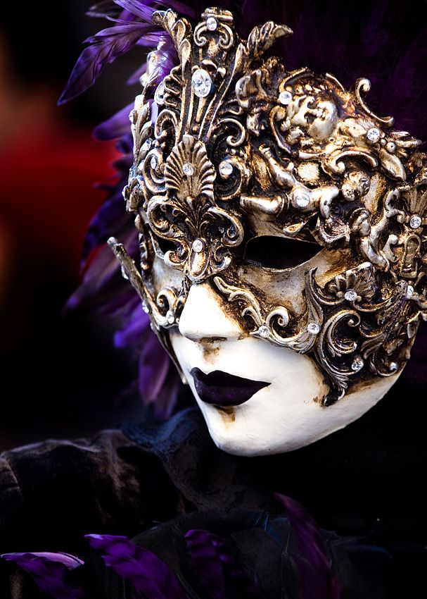 gold mask w/ purple feathers