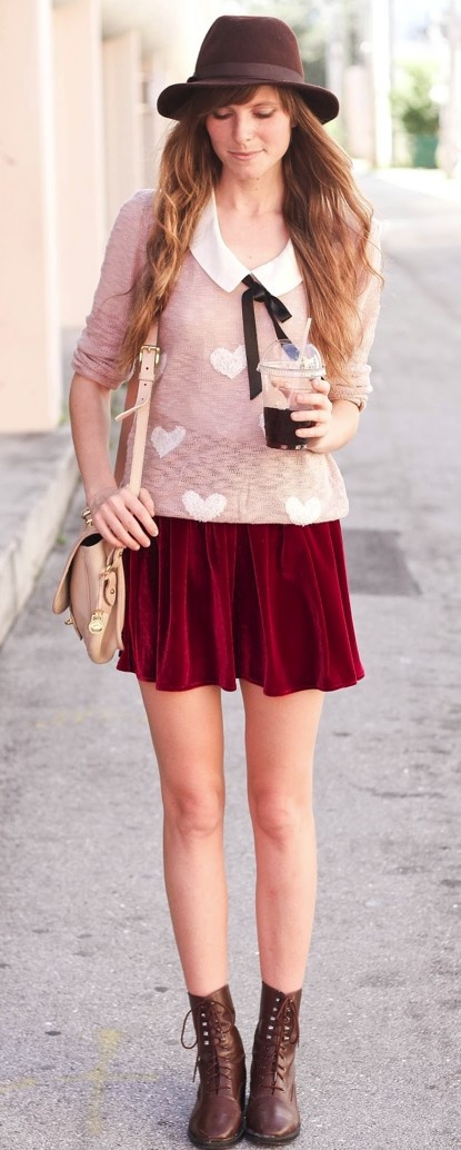 sweater over collared shirt paired with red shirt and brown combat boots