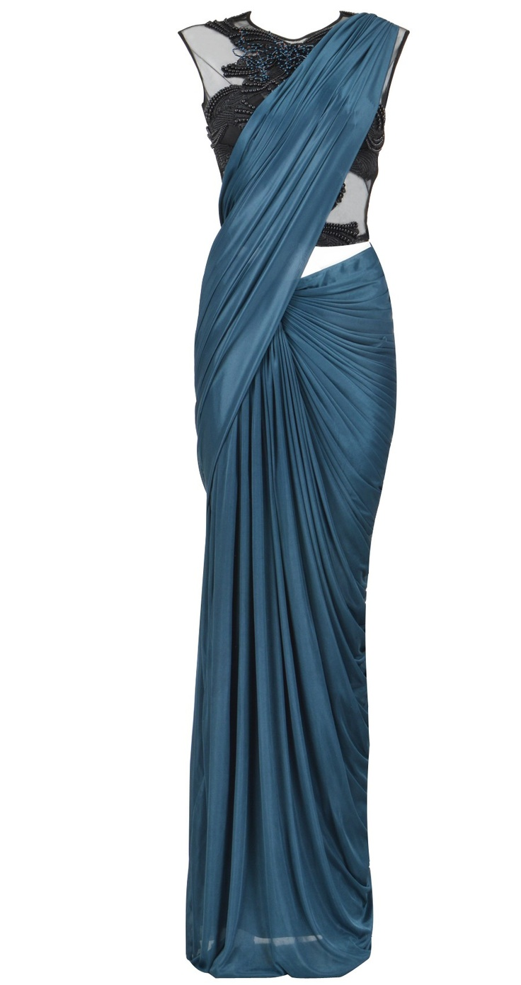 Amit Aggarwal: Teal jersey pre-stitched pleated sari. It comes with a sleeveless blouse with black beaded detailing and an attached skirt petticoat. Stunning!!