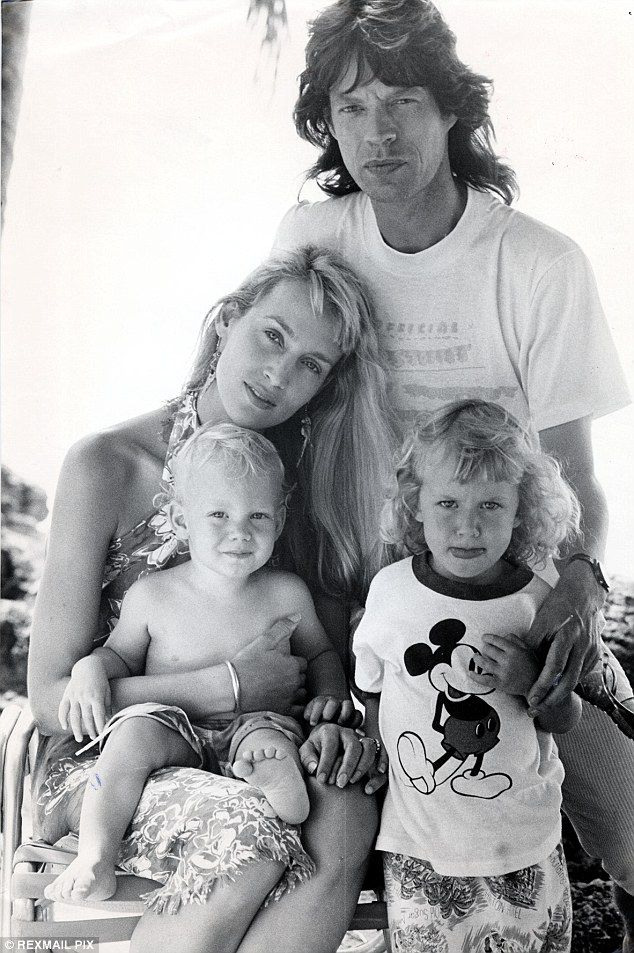 The former model, pictured with ex-husband Mick Jagger and children Elizabeth and James. says her kids are 'grounded'