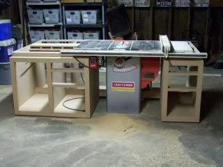 Here is the table saw island that I built for a friend and his shop. By Aaron V  See lumberjocks blog 559dustdesigns