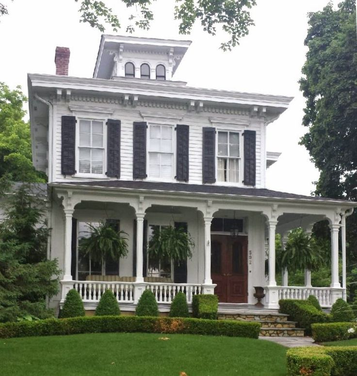 CURB APPEAL - Black and white home with a gorgeous summer porch
