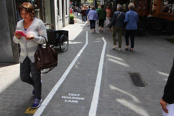 Texting while walking? Belgium now has a lane for that!