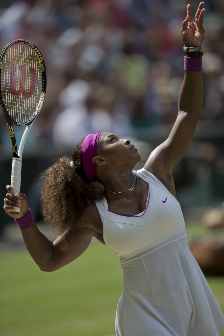 Serena Williams (Washington Kastles) serves to Victoria Azarenka during the 2012 Wimbledon Championships.