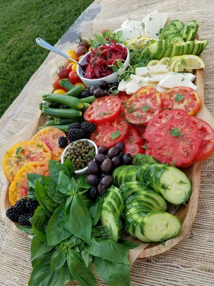 A Summer Platter that I created tonight for a party. The best foods found on this planet are made by nature! -Heirloom Tomatoes -Baby Cougettes -Avocado -Basil -Cucumber -Fresh Herbs -Natural Mozzarella -Pickled Red Onion -Kalamata Olives -Capers Happy Weekend!!! -Rachel